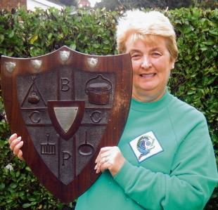 Girlguiding archivist Susan Leng with the shield, the prize for a cookery competition.