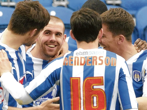 Momentum - Colchester United's players are enjoying their football at present, having gone eight games unbeaten. Picture: STEVE BRADING (CO54783-07)