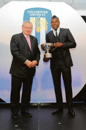 Well done - Colchester United striker Kayode Odejayi (right) receives his player of the year awar