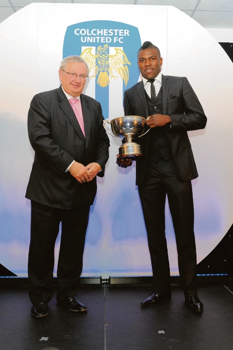 Well done - Colchester United striker Kayode Odejayi (right) receives his player of the year award from Bob Weston of Weston Homes, who are stadium title sponsors and event sponsors of the End-of-Season awards. Picture: RICHARD BLAXALL