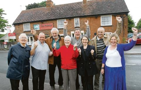 Residents celebrating winning the Village of the Year competition