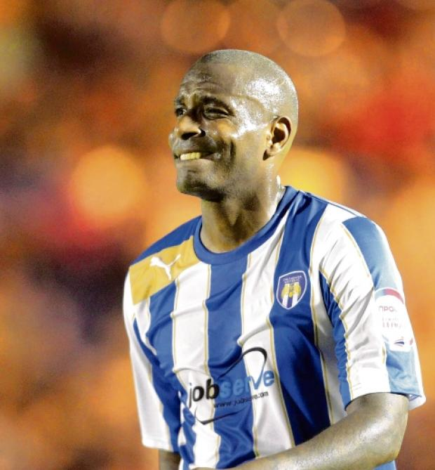 Back in the fold - Clinton Morrison has been named in the Colchester United squad for their trip to play Shrewsbury Town tomorrow.