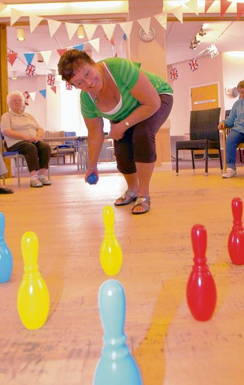 On target – Linda Joslin tries to knock down the skittles at Abbots Activity Centre