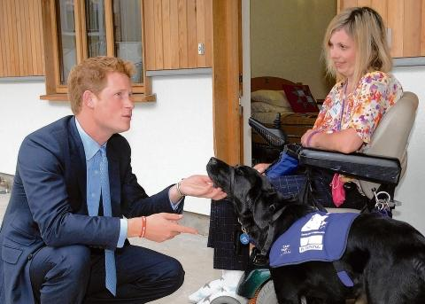 Royal approval – Alison Wyatt and Maddy got to meet Prince Harry last year at the Canine Partners National Training Centre in West Sussex