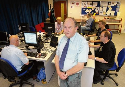 Opportunities Through Technology secretary Brian Snaith in the busy classroom