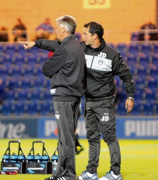 Pointing the way - Colchester United assistant manager Joe Dunne (right) provides some input to former U's boss John Ward. Picture: STEVE BRADING (CO51828-01)