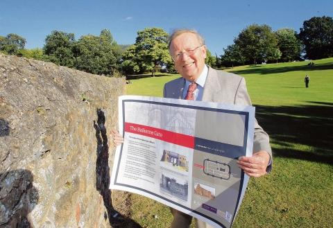 Henry Spyvee with one of the new Colchester Roman wall signs