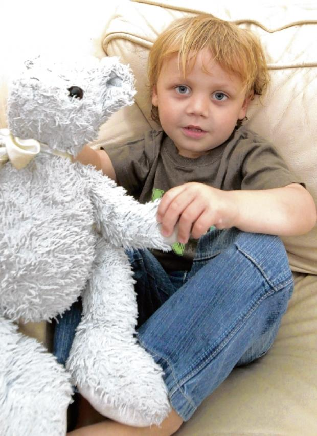 Benjamin Laker, three, with his teddy bear.