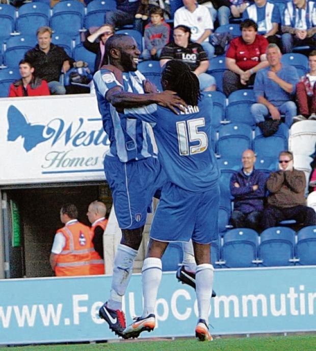 Celebration - goalscorer Jabo Ibehre celebrates one of his goals with team-mate Marcus Bean, during the U's 3-1 win over Hartlepool United. Picture: STEVE ARGENT (CO70230-56)
