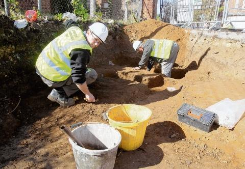 Archaeologists investigate burial remains found under the car park in Butt Road, Colchester.
