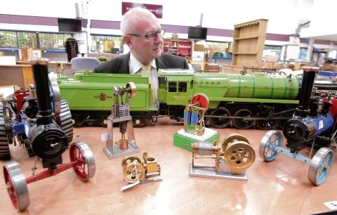 Toy specialist Michael Bowles with one of the lots for Saturday's auction.