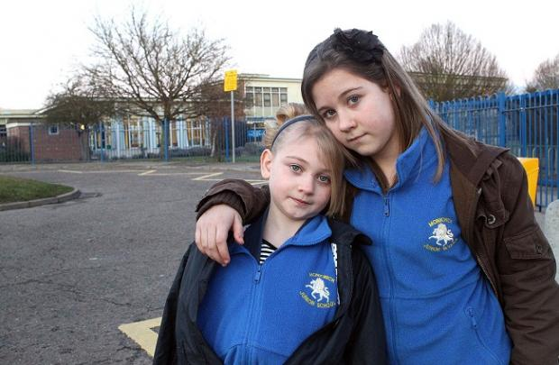 Campaign success: Tiana Page, eight, was knocked down in School Road. Pictured with sister Brooke Page,10.