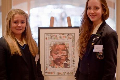 St Mary's students (left to right) Zoe Jervis and Polly Banks with their artwork, 'Together as One', which was judged the winner of the national Arts & Minds Competition