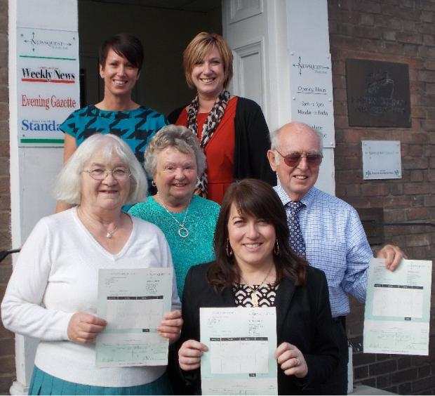 Tanya Rees and Karen Mole (back row) present cheques to (from left) Margaret Quinn, Wendy Wilson, Jo Weaver and Brian Wilson