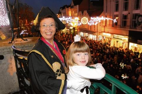 Last year's winner Violet Wilson, six, switches on the lights with mayor at the time Helen Chuah