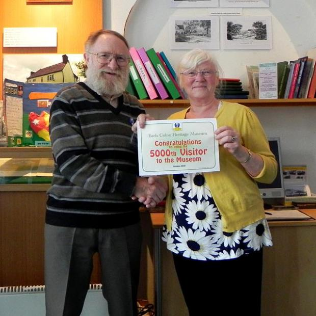 Honorary curator Brian Alderman presents Anne-Marie Tilbrook, the 5,000th visitor, with a certificate