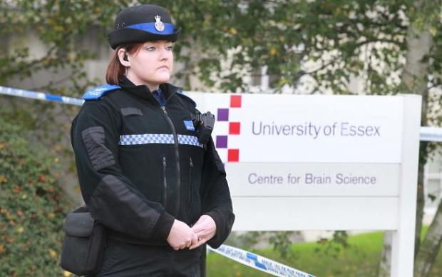 Police at Essex University yesterday after a woman was attacked
