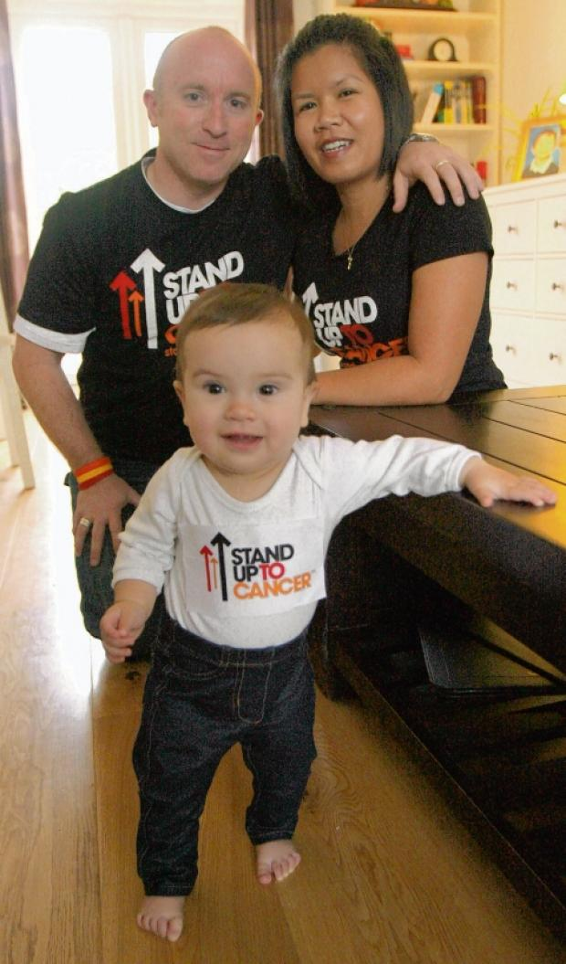 Nine-month-old Mia McGlown was sponsored by dad Martin to stand up as many times as she could during the Stand Up for Cancer TV broadcast on Friday