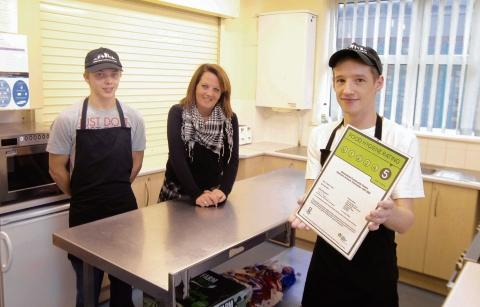 Greenstead Community Centre, proud owners of a 5-star rating for hygiene. Centre manager Toni Knights with kitchen assistant Ross Mason and head chef Aaron Winter (right) in the kitchen.