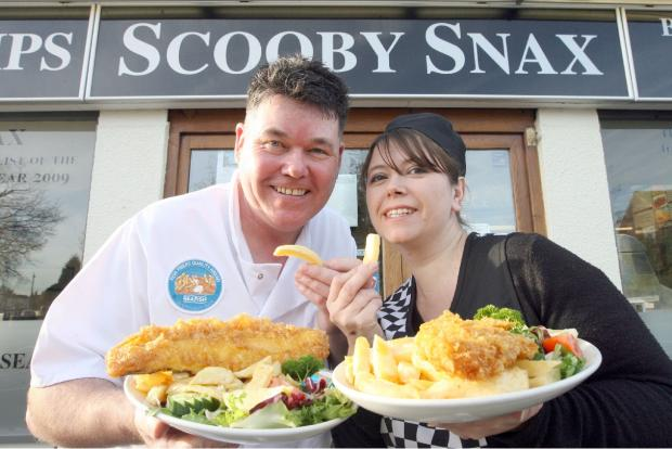 Owner John McNeill and partner Andrea Smith outside Scooby Snax after winning a regional fish and chip shop award in 2009