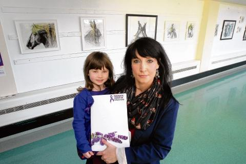 Raising awareness: Claire with her daughter Niamh