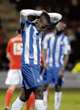 Change in fortunes - Gavin Massey looks dejected after Colchester United lost 3-2 at Crewe Alexandra, to fall to a third successive defeat.