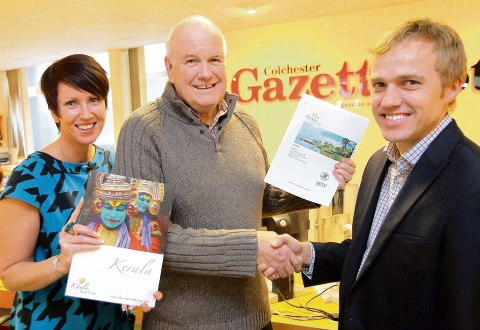 Gazette prize winner Malcolm Smith (centre) receives his prize from Nigel Barton, managing director of Kerala Travel Centre and Tanya Rees, promotions manager for the Gazette.