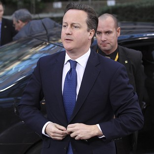 Prime Minister David Cameron arrives for the EU summit in Brussels (AP)