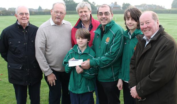 Essex County Standard: Colin Grant, Graham Adams, Reg White's son Robert, Richard Hunt and treasurer Tony Spurling, along with Rowan Hunt, ten, and Josh Hunt, 13, receive a cheque from the memorial fund. Picture courtesy of Jacque Collyer-Smith.