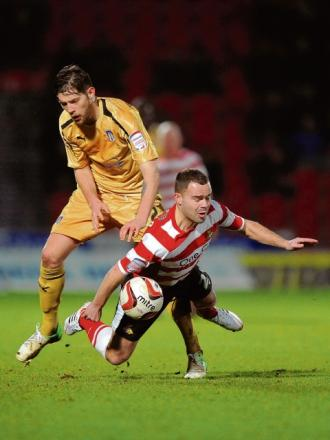 Tussle - Anthony Wordsworth does battle during Colchester's 1-0 defeat at Doncaster Rovers. Picture: RICHARD BLAXALL