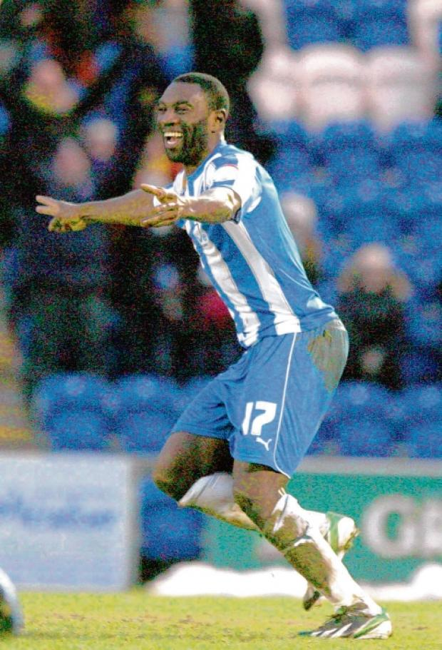 All smiles - Jabo Ibehre is a happy man after scoring upon his return to Colchester United, in their 2-0 win over Walsall. Picture: SEANA HUGHES