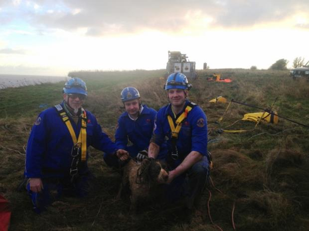 Coastguard rescue officers Andy Rutson-Edwards, Steve Duggan and James Whitfield with Buddy.