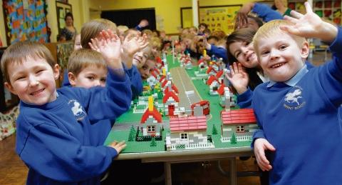 Pupils from Monkwick Infants School create their own Lego town.