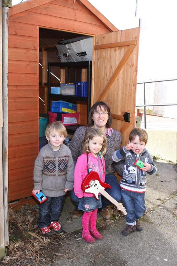 From left, Noah, Molly, Emma Appleton and Finlay outside the Wivenhoe Toddler Group's new toy shed.