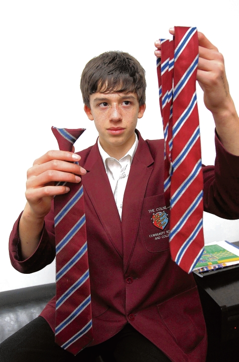 Max Richmond with his real tie (right) and the clip-on he is supposed to wear.