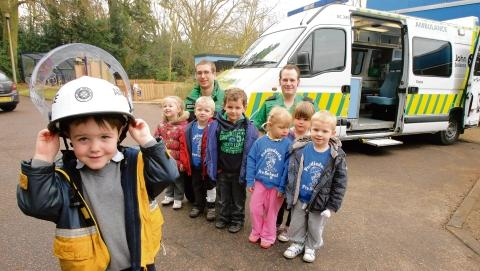 Children at Puddleducks Pre-School get a chance to look around an ambulance and learn how to bandage. Ethan Glorfindel with classmates and Wayne David and Chris Taylor from St St John Ambulance.