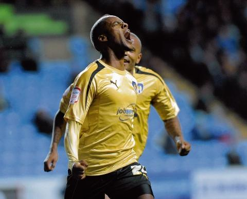 Joy - Gavin Massey celebrates his goal for Colchester United at Coventry City. Picture: WARREN PAGE