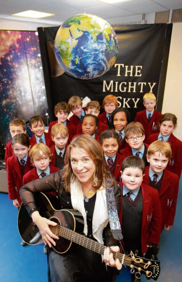 Beth Nielsen Chapman with pupils at Holmwood House School.