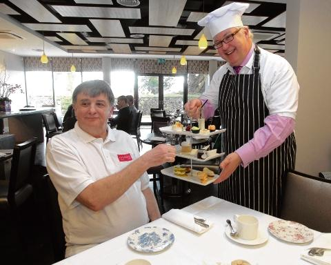 Councillor Kevin Bentley serves afternoon tea to Visit Essex chairman George Kieffer.
