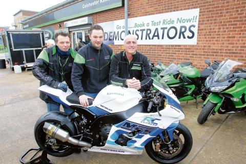 Essex County Standard: Kawasaki open day at King Edward Quay, Colchester. James Hogben (manager), Luke Gregory (owner) with Nick Morgan, race team manager with the 2013 TT Isle of Man racing machine.