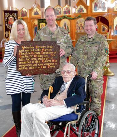 Garrison Commander Col Mike Newman and Padre David Kingston with George Manley and his granddaughter Jane Weller.