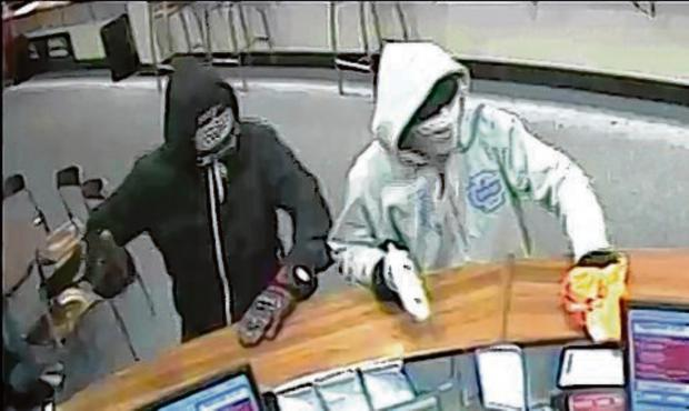 Armed robbers raid bookmakers