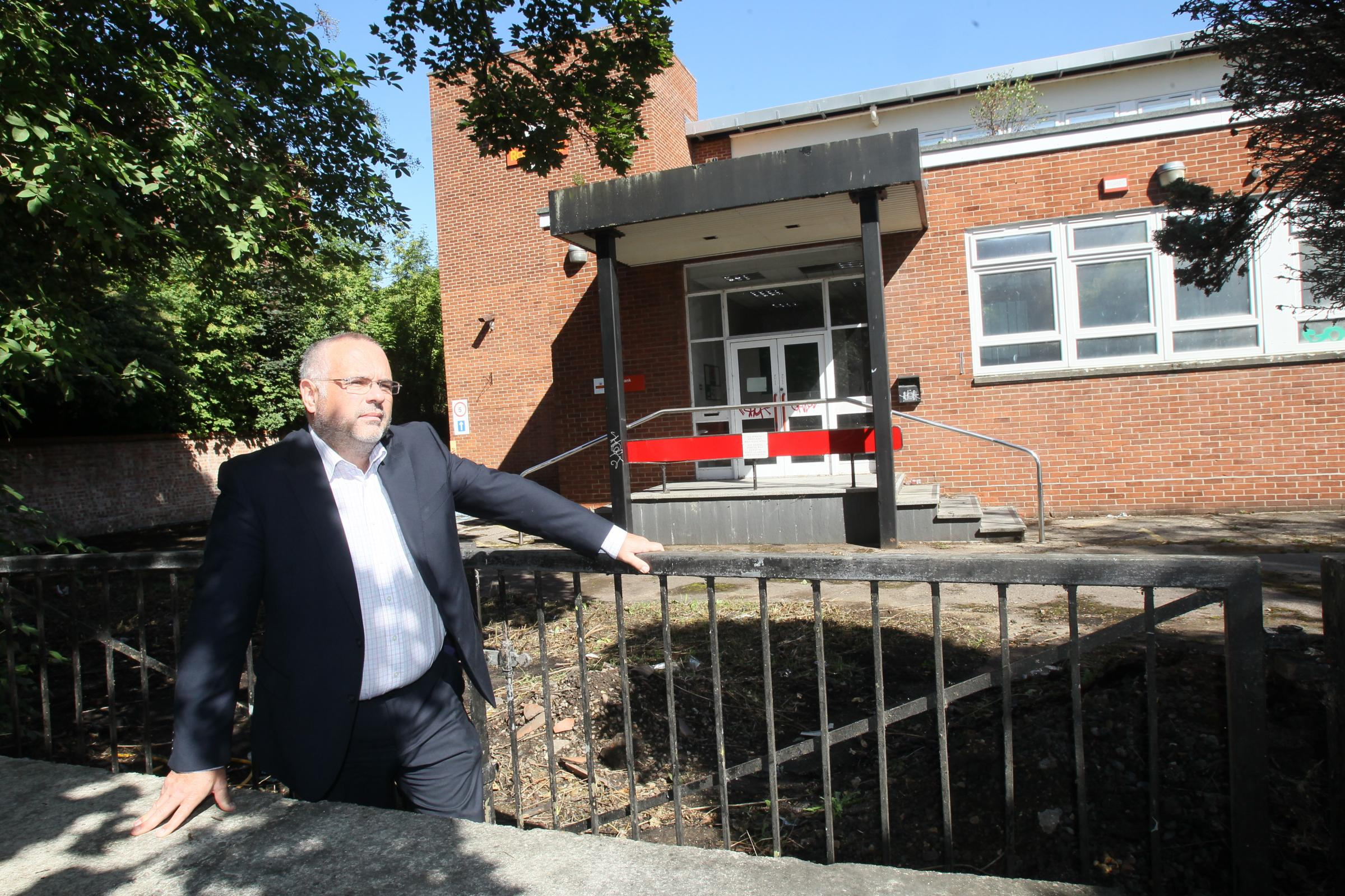 "Frustrating – councillor Tim Young outside the ""eyesore"" Royal Mail depot due to make way for a Premier Inn"