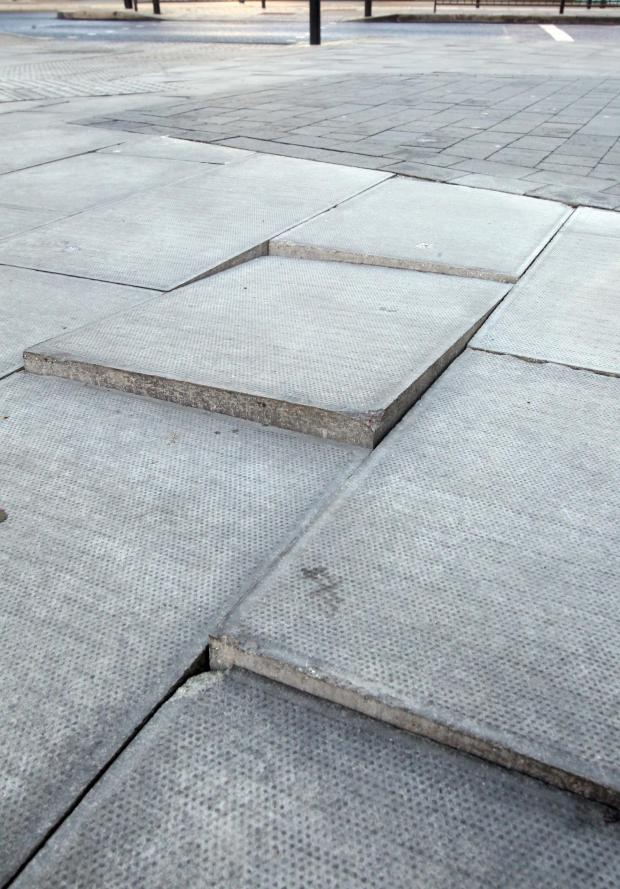 Essex County Standard: Some of the broken paving slabs at Colchester Bus Station.