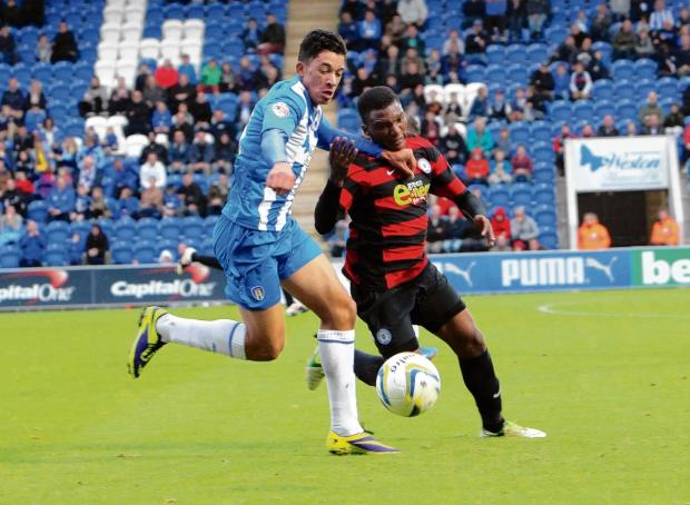 Looking for a repeat - goalscorer Macauley Bonne takes on Peterborough's Kgosi Ntlhe in the U's 1-0 win over Posh, last October.