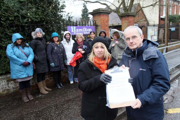 Parent Sam Hempstead with headteacher Clive Reynolds and other parents concerned about the council's parking proposals.