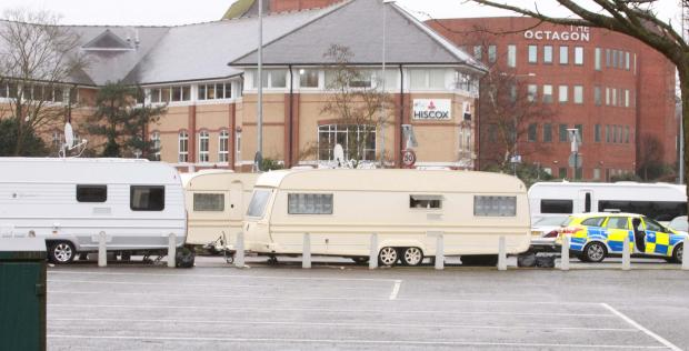 Travellers pitch camp in town car park