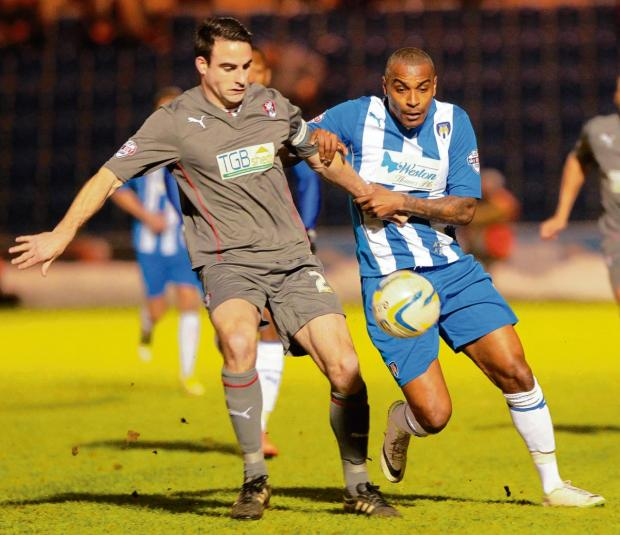 Essex County Standard: Tussle - Colchester United striker Clinton Morrison battles for possession during his side's 0-0 draw with Rotherham United. Picture: NIGEL BROWN (CO90942-06)