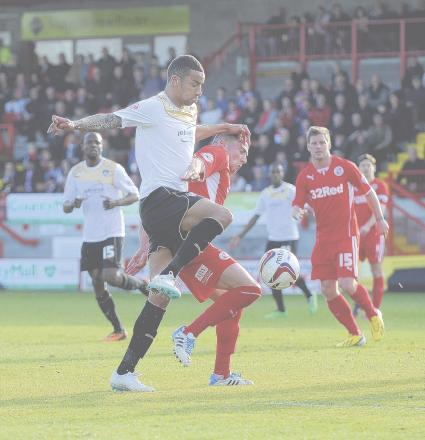 In the thick of it - Colchester United midfielder Craig Eastmond tussles with Mike Jones in the U's 1-0 defeat at Crawley Town. Picture: WARREN PAGE
