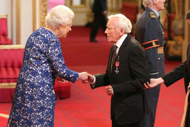 Mr Slater receives his MBE from the Queen at Buckingham Palace on Friday.